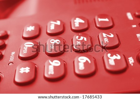 red telephone keypad with buttons - stock photo