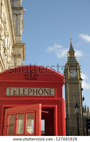 Red telephone kiosk and Big Ben, London - stock photo