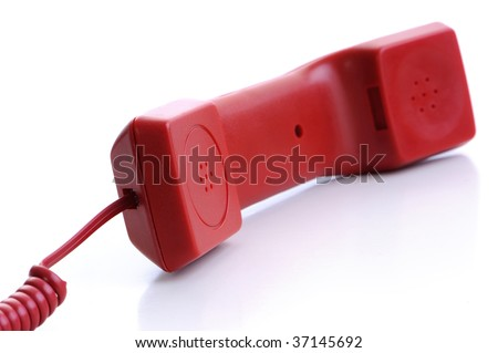 red telephone receiver on white background