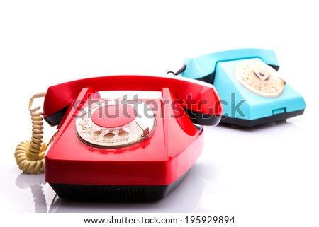Red telephones on white - stock photo