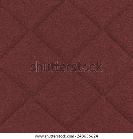 red textile background, seams, squares