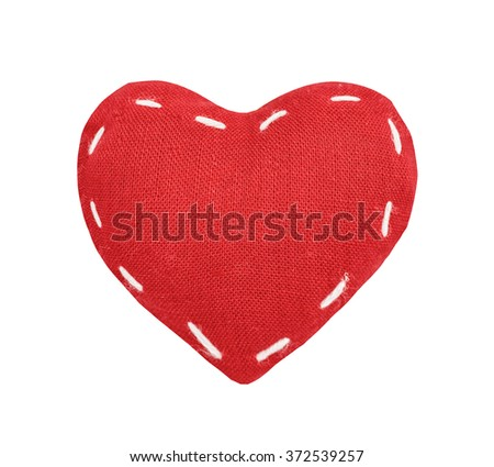 Red textile, fabric heart, St. Valentine's Day, close up, isolated on the white