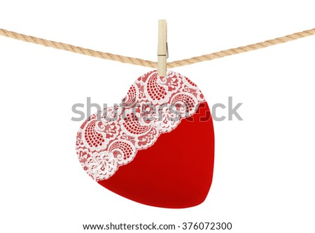red textile heart with lace hang on clothespin isolated on white background - stock photo