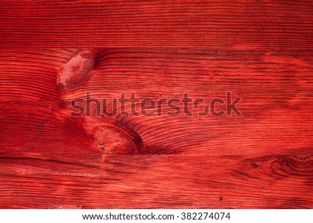Red texture of wooden board with knots, closeup - stock photo