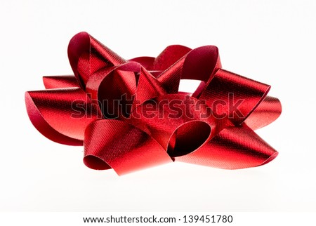 Red textured bow isolated on a white background. - stock photo