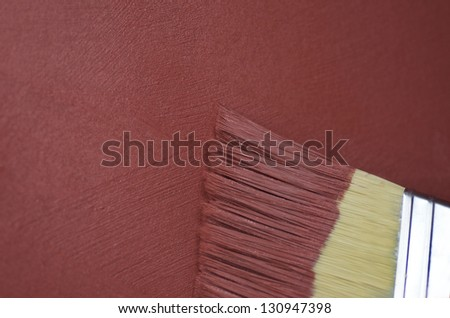Red Textured Paint And Brush - stock photo