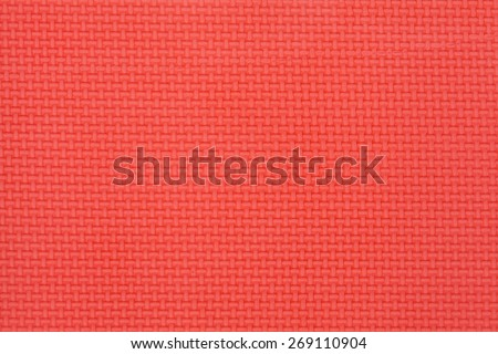 red textured surface of a mat - stock photo