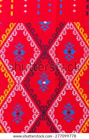 Red thai silk fabric pattern background.