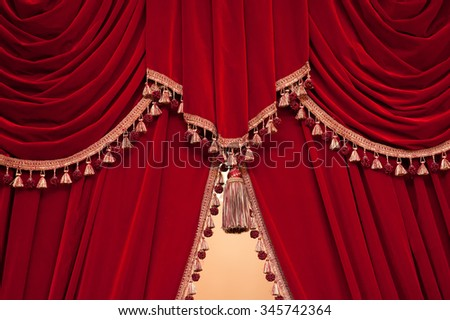 red theater curtain with tassels. - stock photo