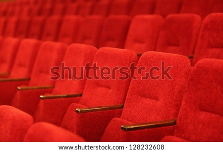 Red theatre armchairs in a row