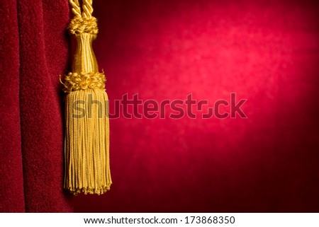 Red theatre curtain and yellow tassels