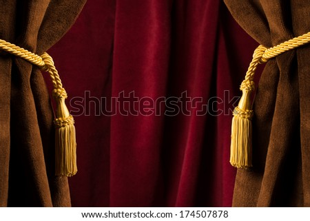 Red theatre curtains and yellow tassels