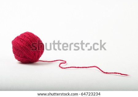Red thread clew isolated over grey gradient background (macro shot) - stock photo