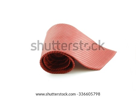 Red tie coiled isolated on white background - stock photo