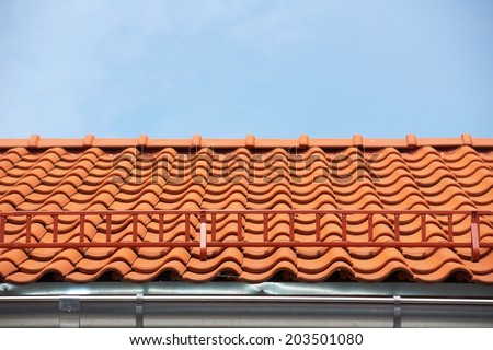 Red tile roof with stairs