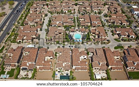 Red Tile rooftops and swimming pool overhead view - stock photo
