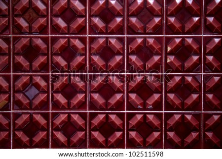 red tiles of the 70 forming a background - stock photo