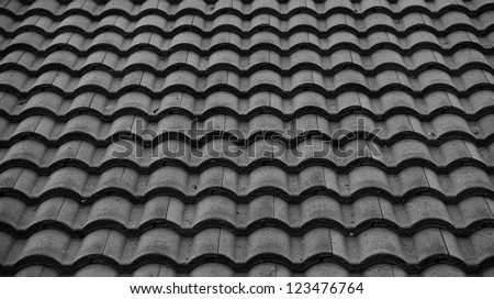 Red tiles roof background,Black and white. - stock photo