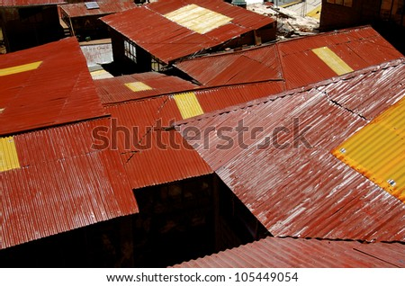 Red Tin Rooftops- Red tin rooftops on Taquile Island, Lake Titicaca, Peru - stock photo