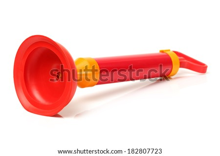 Red toilet plunger on white background