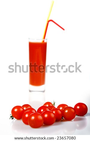 red tomato and tomato juice on white