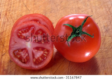 red tomato chopped on a chopping board