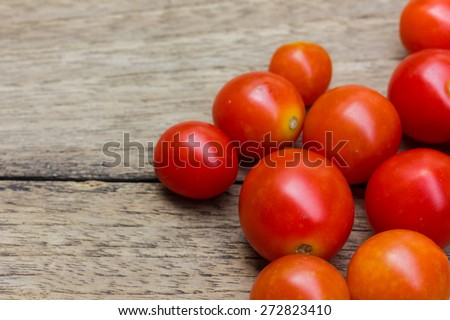 red tomato on the wood table - stock photo