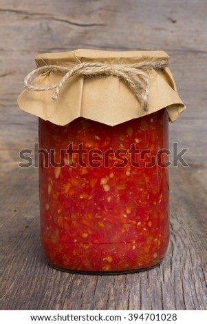 red tomato sauce with sweet pepper in glass jar closeup. home canning - stock photo