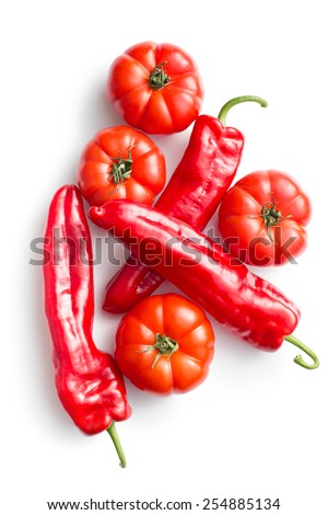 red tomatoes and peppers on white background - stock photo