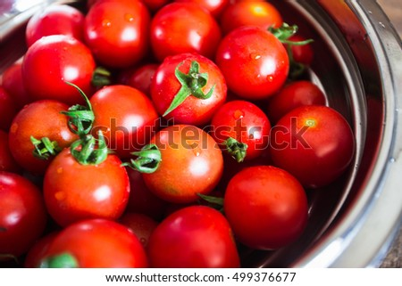 Red tomatoes background. Group of tomatoes in a plate