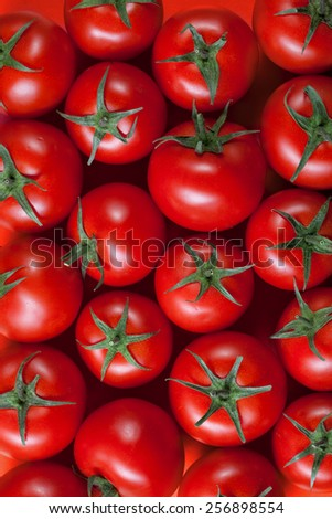red tomatoes background. top view - stock photo
