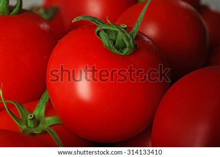 Red tomatoes closeup - stock photo
