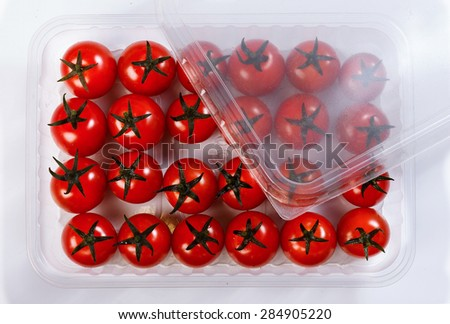 Red tomatoes in a plastic container