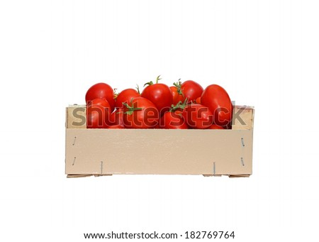 Red tomatoes in a wooden box isolated on white background