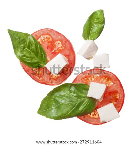 red tomatoes, mozzarella and basil isoalted on white - caprese, traditional italian ingrindients, top view - stock photo