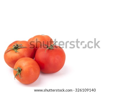 Red tomatoes on a white background   - stock photo