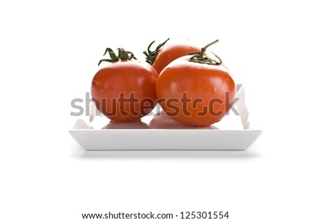 red tomatoes on a white dish