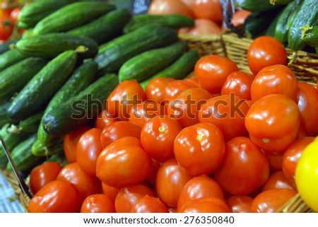 red tomatoes on display at a supermarket - stock photo