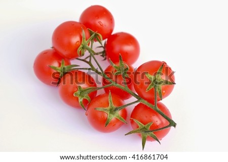 Red tomatoes on the white background, overhead horizontal view. Healthy fresh vegetable tomato on branch.