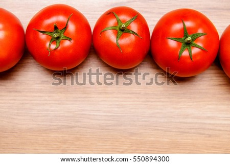 red tomatoes on wooden ground from above