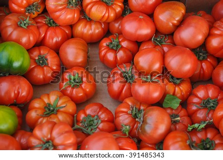 Red Tomatoes (Solanum lycopersicum) vegetables vegetarian food