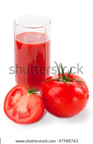 red tomatoes with tomato juice in glass