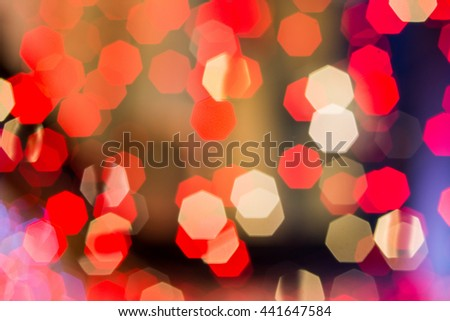 Red tone and colorful blur bokeh light. Defocused background with space. Defocused abstract red Christmas background, soft defocused holidays light background. Process with grain artifacts style - stock photo