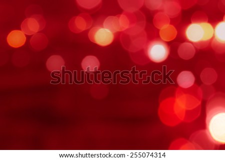 Red tone blur bokeh light. Defocused background with space. - stock photo