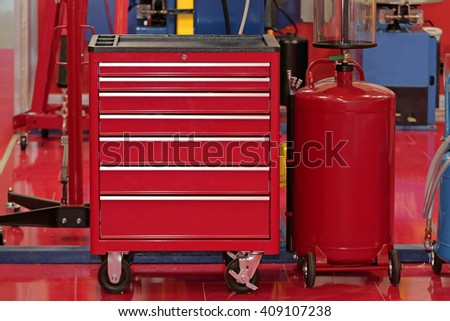 Red Tool Chest With Drawers in Garage Service - stock photo