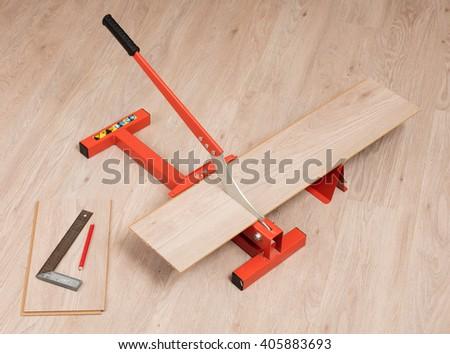 Red Tool Cutting Laminate On Laminate Stock Photo Royalty Free