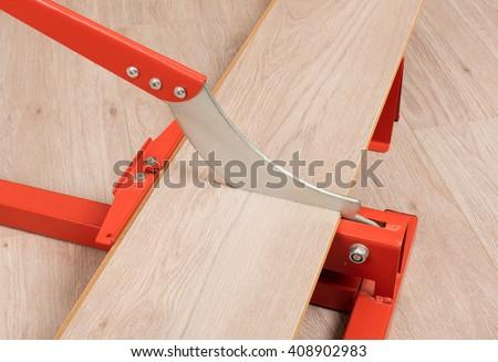 Red Tool Cutting Laminate On Laminate Stock Photo 408902983