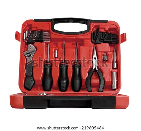 Red toolbox with different instruments isolated on white - stock photo