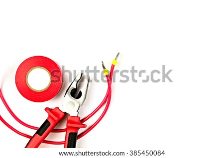 Red tools collection - electrical cable, pliers, insulating tape - stock photo