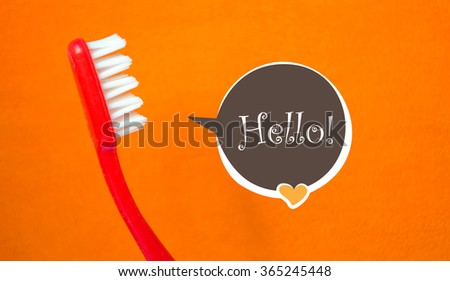 Red toothbrush and a hello bubble talk - stock photo